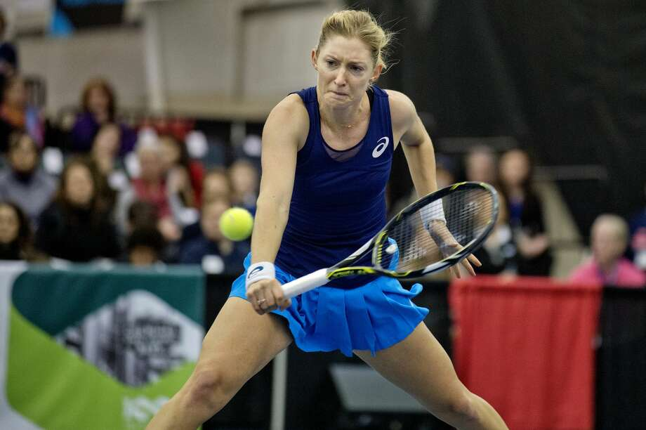Julia Boserup returns the ball to Tatjana Maria in their semifinal match during the Dow Tennis Classic on Saturday at the Greater Midland Tennis Center. Maria won the match. Photo: NICK KING | Nking@mdn.net