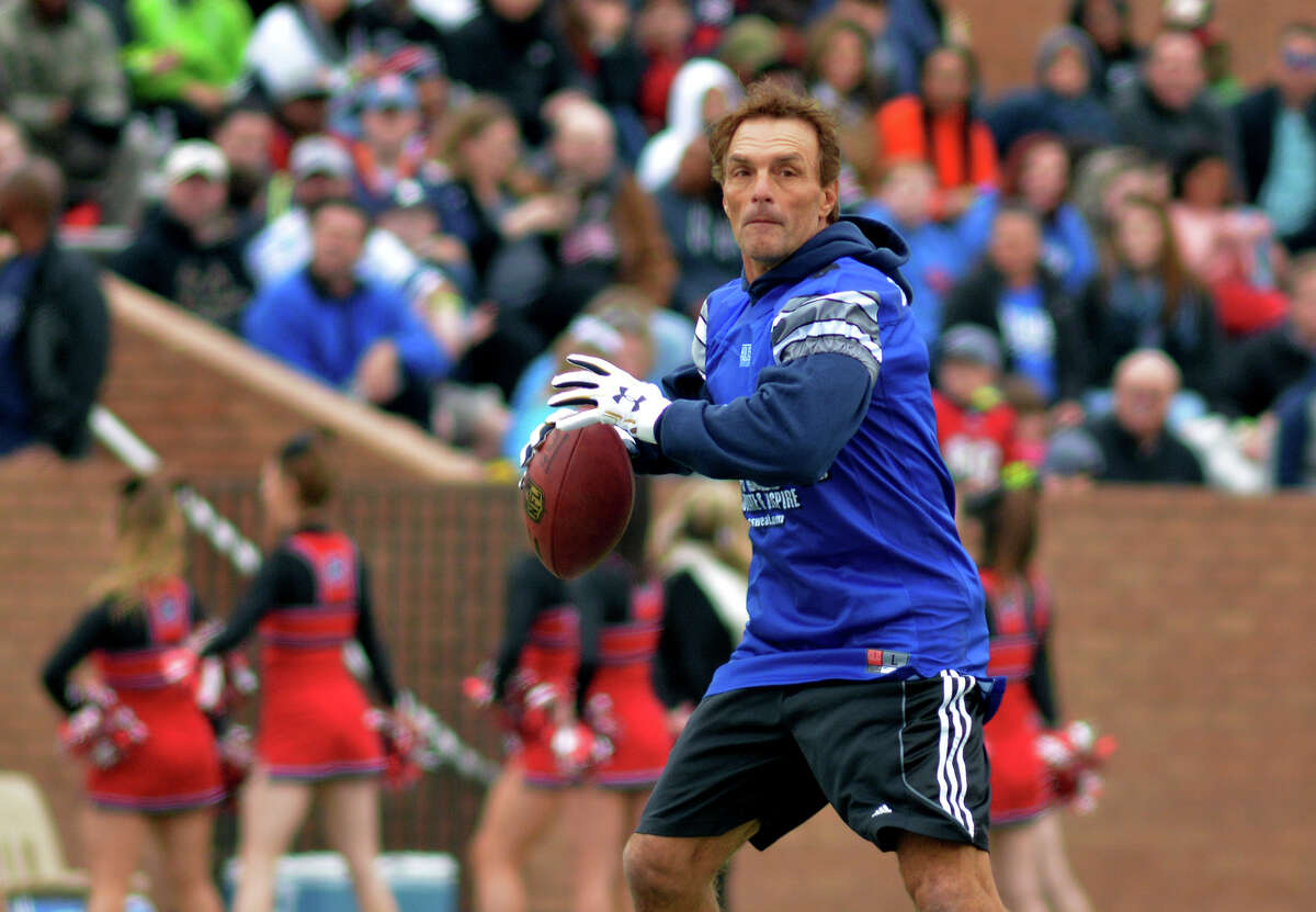 Doug Flutie targets a receiver during first quarter of the Celebrity Flag Football Challenge on Saturday at Rhodes Stadium in Katy. One young fan yelled at Flutie,