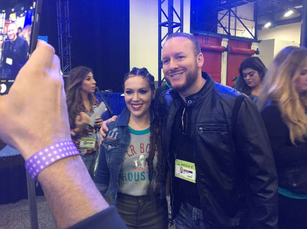 FILE - Houston sports radio host Adam Clanton and actress Alyssa Milano pose for a photograph during a Super Bowl LI promotional event in Houston, Texas. Monday, Clanton and Sports Talk 790 parted ways.