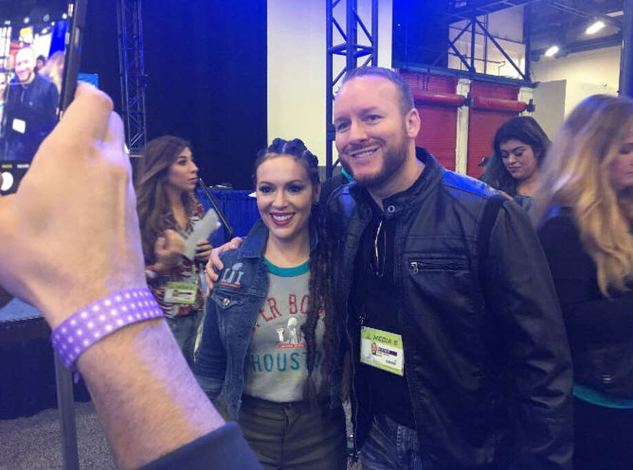 FILE - Houston sports radio host Adam Clanton and actress Alyssa Milano pose for a photograph during a Super Bowl LI promotional event in Houston, Texas. Monday, Clanton and Sports Talk 790 parted ways. Photo: Reader Submission