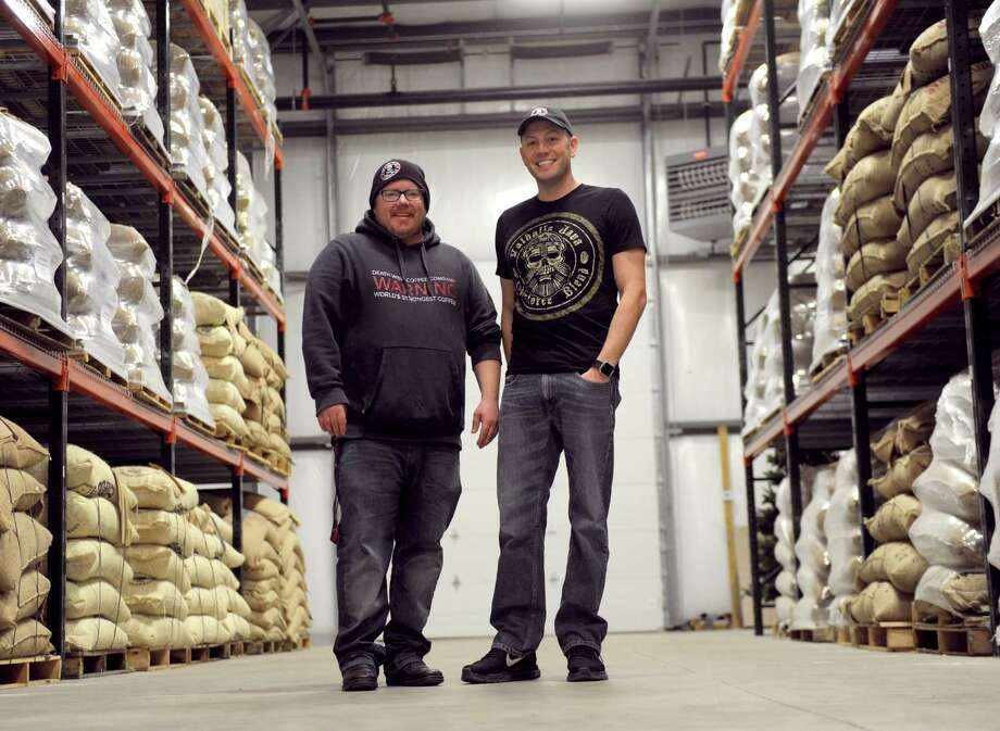 John Swedish and Death Wish Coffee founder Mike Brown stand in their new, 15,000-square-foot produciton facility in Round Lake, N.Y. Feb. 4, 2017. The company recently moved their operations to accomodate an influx of business after it won a free commercial slot at the 2016 Super Bowl. (Robert Downen/Times Union)