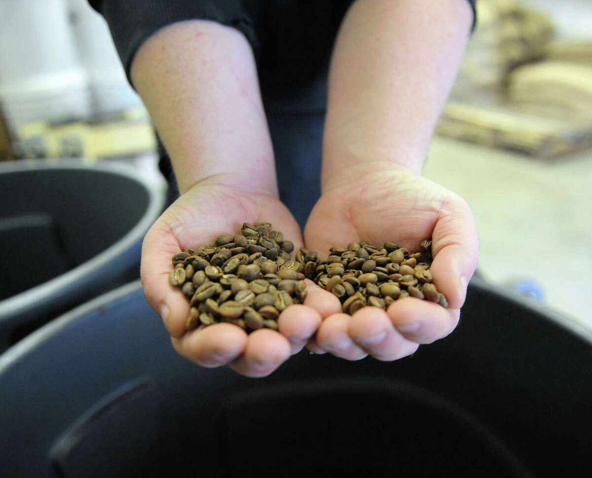 John Swedish, who oversees product develoment for Death Wish Coffee, shows off some specialty beans at the company's new facility in Round Lake, N.Y. Feb. 4, 2017. The company recently moved their operations to accomodate an influx of business after it won a free commercial slot at the 2016 Super Bowl. (Robert Downen/Times Union)