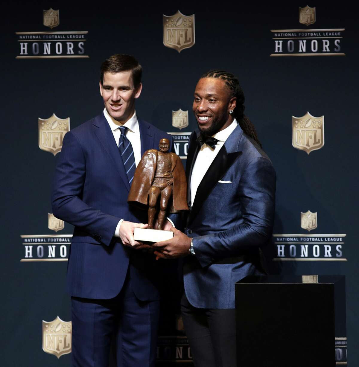 Walter Payton NFL Man of the Year winners Eli Manning left, and Larry Fitzgerald right, during the NFL Honors media availability at the Wortham Center Saturday, Feb. 4, 2017, in Houston. ( James Nielsen / Houston Chronicle )