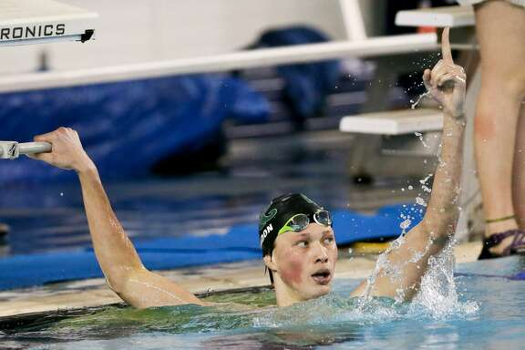 Reagan's Zach Yeadon celebrates after winning the boys 500-yard freestyle during the Region VII-6A swimming championships at Davis Natatorium on Feb. 4, 2017. Yeadon set a new regional record and a Davis pool record with a time of 4:21.26.