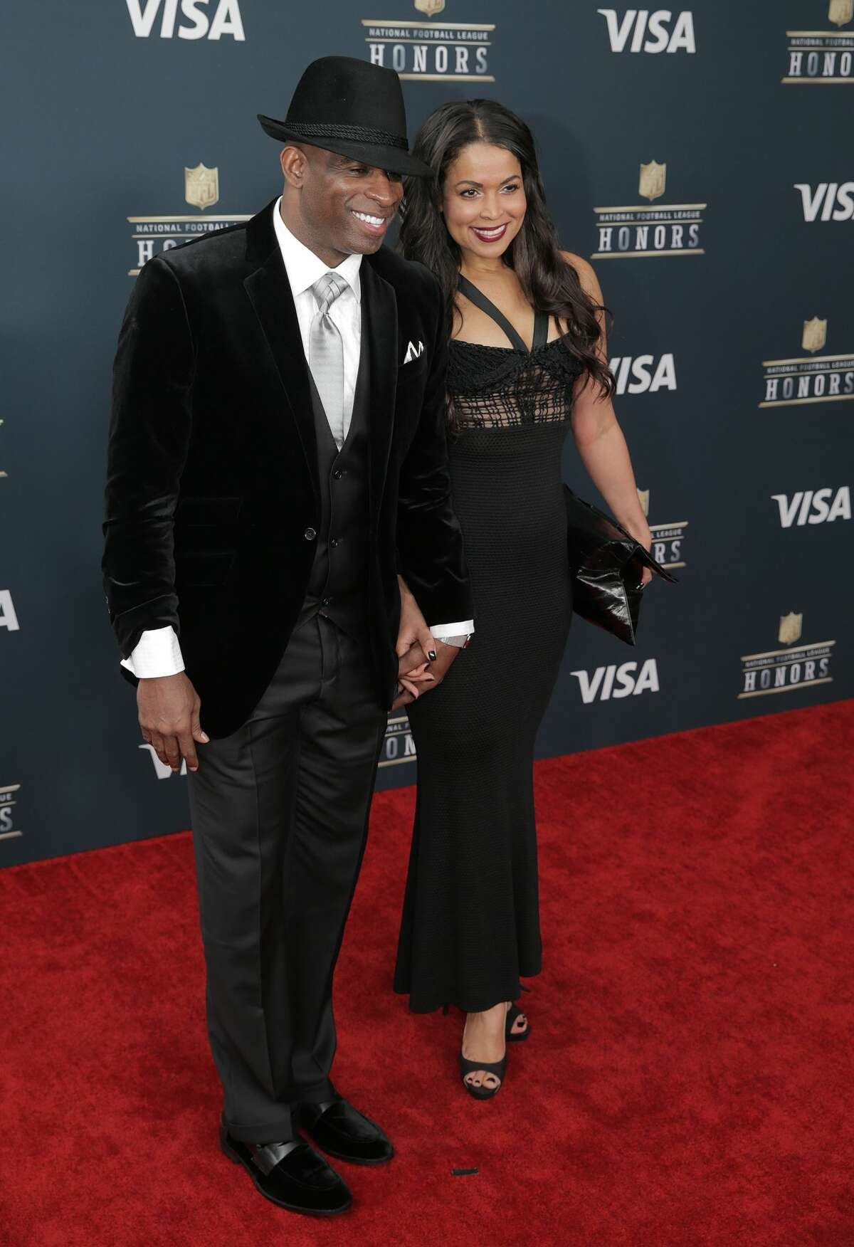 NFL legend Deion Sanders poses on the red carpet of the NFL honors night at the Wortham Theater Center on Saturday, Feb. 4, 2017, in Houston. ( Elizabeth Conley / Houston Chronicle )