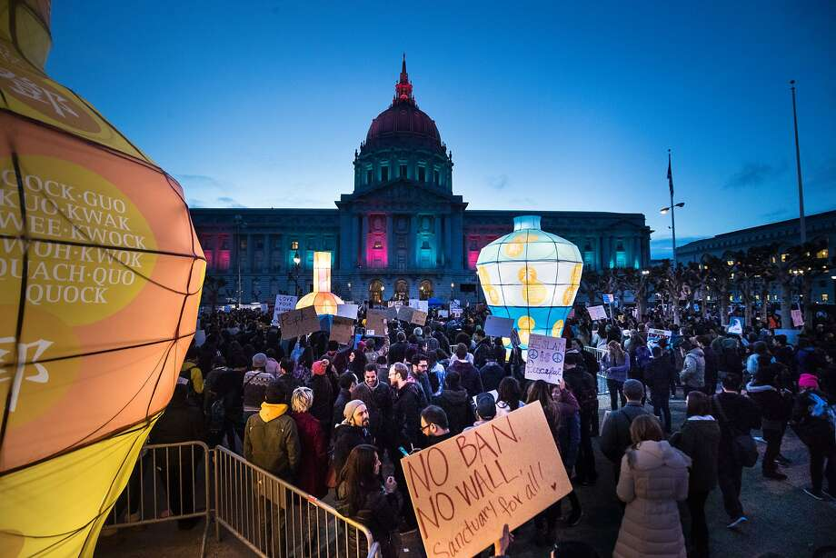 Crowd gather on the Civic Center Plaza to protest Trump's plan for a wall on the Mexican border and ban on immigrants from a number of mainly Muslim counties on Saturday, Feb. 4, 2017 in San Francisco, CA Photo: Paul Kuroda, Special To The Chronicle