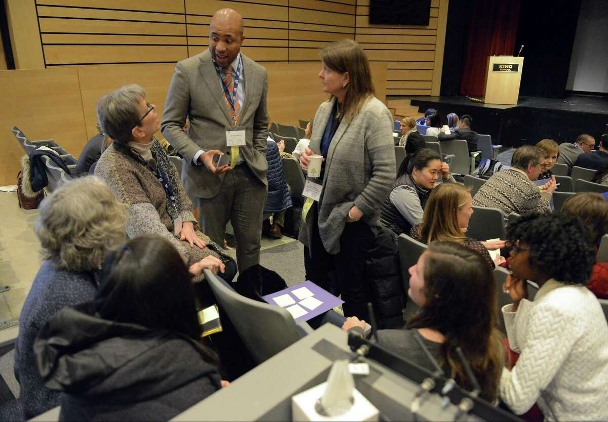 Dr. Derrick Gay, center, talks with educators participating in a breakout session during the Global Education Leadership Symposium at King School in Stamford on Feb. 4, 2017. Gay, an internationally recognized consultant to educational, artistic and philanthropic organizations around the world, was the event's keynote speaker.