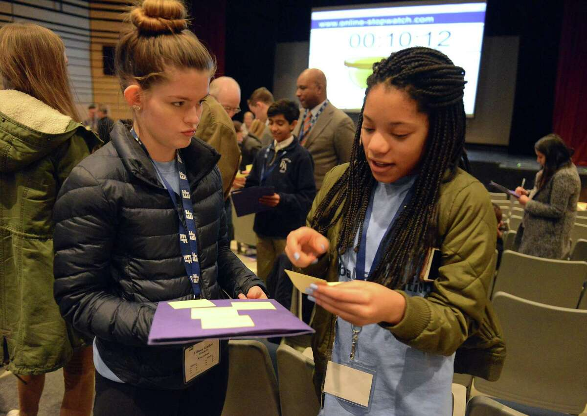 From left, Lily Gordon, a Junior at King School and Kim Villard, a Freshman at King School, participate in an exercise during the Global Education Leadership Symposium at King School in Stamford on Feb. 4, 2017. Dr. Derrick Gay, an internationally recognized consultant to educational, artistic and philanthropic organizations around the world, was the event's keynote speaker.