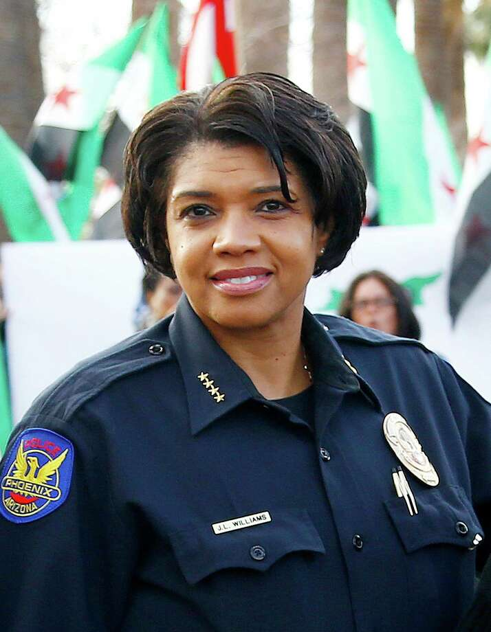 In this Jan. 16, 2017 photo, Phoenix Police Chief Jeri Williams poses for a photograph with other city leaders prior to leading a Martin Luther King Jr. Day march in Phoenix. Williams is among the growing number of women heading departments, many in need of image makeovers.   (AP Photo/Ross D. Franklin) ORG XMIT: LA603 Photo: Ross D. Franklin / Copyright 2017 The Associated Press. All rights reserved. This m