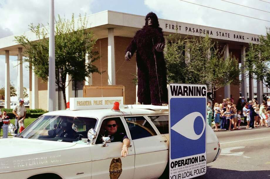 Members of the Crime Prevention Unit participate in a parade in the late 1970s. No one seems to know what is going on with the gorilla. Photo: Pasadena Police Department/Facebook