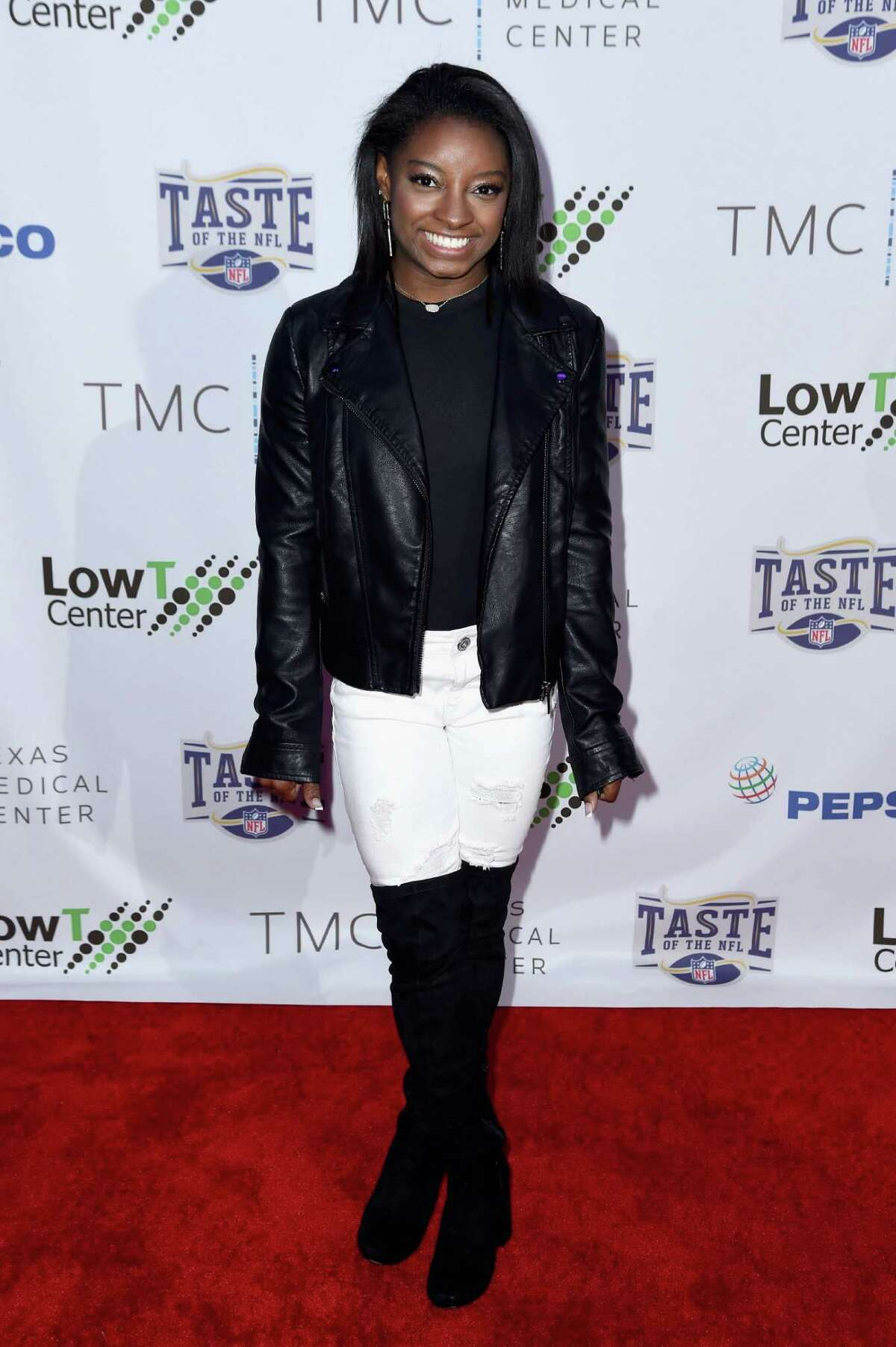HOUSTON, TX - FEBRUARY 04: Olympic gymnast Simone Biles attends the Taste Of The NFL 'Party With A Purpose' at Houston University on February 4, 2017 in Houston. at University of Houston on February 4, 2017 in Houston, Texas.