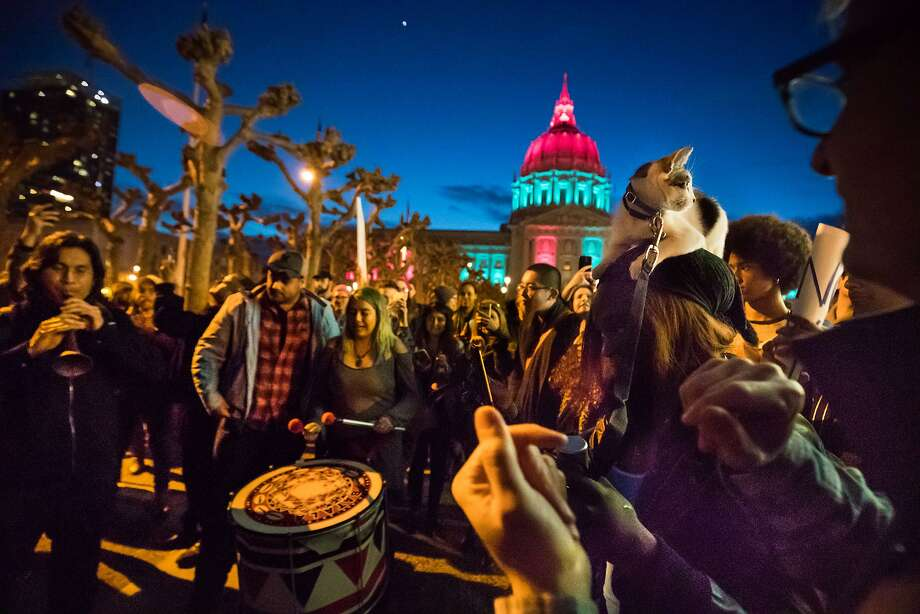 Calvin Lai on the zurna and Fabiola Danielle Quiroz on a large drum play to participants after the rally, including Mioshia Syon's cat Mafia on Saturday, Feb. 4, 2017 in San Francisco, CA  Protest against trump plan for wall on Mexican border and ban on immigrants and visitors from a number of mainly Muslim countries at the Civic Center Plaza.  Organizers are calling it a peaceful protest expected to draw more than 6,000 people. Photo: Paul Kuroda, Special To The Chronicle