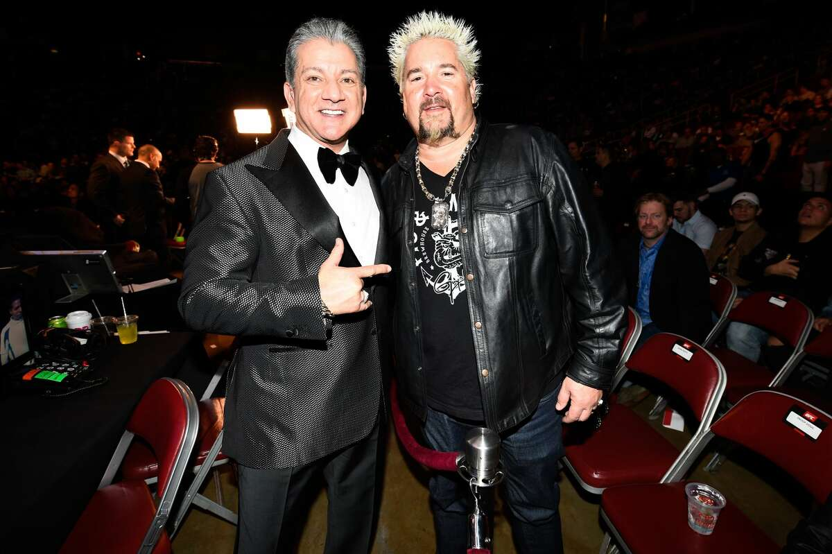 HOUSTON, TX - FEBRUARY 04: UFC announcer Bruce Buffer and chef and television personality Guy Fieri watches the fights during the UFC Fight Night event at the Toyota Center on February 4, 2017 in Houston, Texas. (Photo by Jeff Bottari/Zuffa LLC/Zuffa LLC via Getty Images)