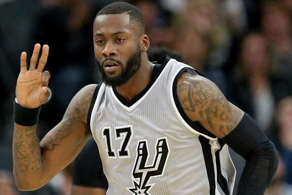 Spurs' Jonathon Simmons reacts after making a 3-pointer during second half action against the Denver Nuggets on Feb. 4, 2017 at the AT&T Center.