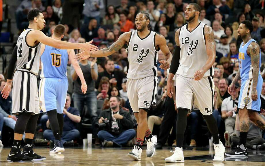 Spurs' Danny Green (from left) celebrates with Kawhi Leonard and LaMarcus Aldridge after a Leonard basket during second half action against the Denver Nuggets on Feb. 4, 2017 at the AT&T Center. Photo: Edward A. Ornelas /San Antonio Express-News / © 2017 San Antonio Express-News