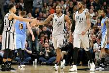 Spurs' Danny Green (from left) celebrates with Kawhi Leonard and LaMarcus Aldridge after a Leonard basket during second half action against the Denver Nuggets on Feb. 4, 2017 at the AT&T Center.