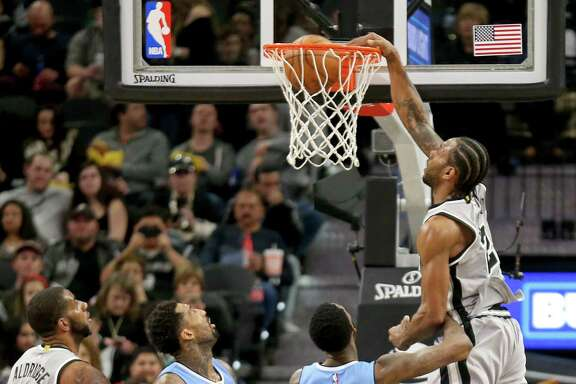 San Antonio Spurs' Kawhi Leonard dunks over Denver NuggetsÕ Will Barton as San Antonio Spurs' LaMarcus Aldridge (from left) and Denver NuggetsÕ Wilson Chandler look on during second half action Saturday Feb. 4, 2017 at the AT&T Center. The Spurs won 121-97.
