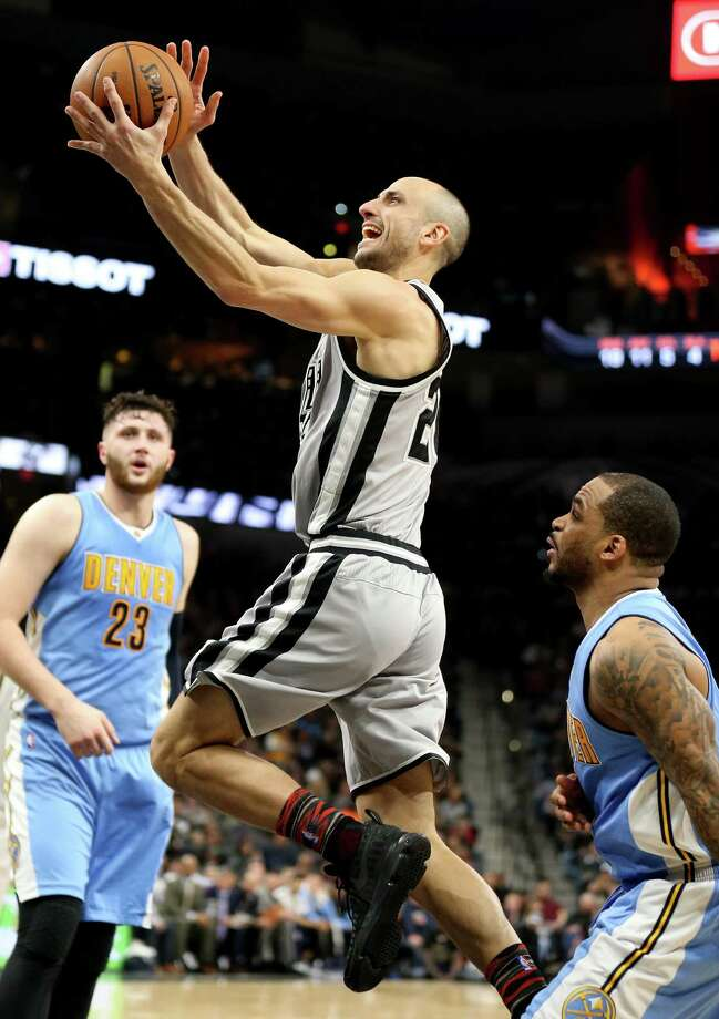 Spurs' Manu Ginobili shoots around the Denver Nuggets' Jameer Nelson (right) during first half action on Feb. 4, 2017 at the AT&T Center. Photo: Edward A. Ornelas /San Antonio Express-News / © 2017 San Antonio Express-News