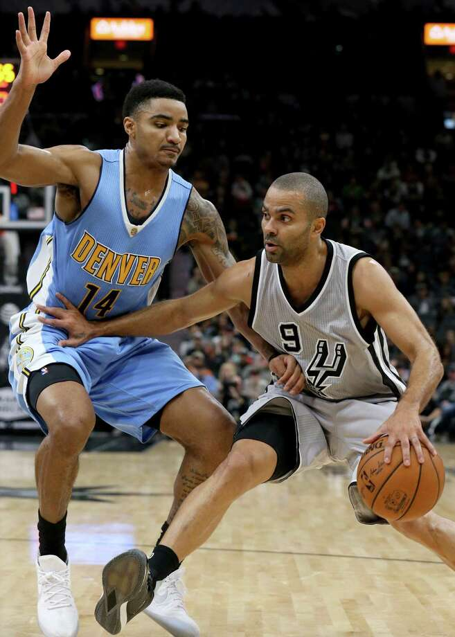 San Antonio Spurs' Tony Parker look for room around Denver NuggetsÕ Gary Harris during first half action Saturday Feb. 4, 2017 at the AT&T Center. Photo: Edward A. Ornelas, Staff / San Antonio Express-News / © 2017 San Antonio Express-News