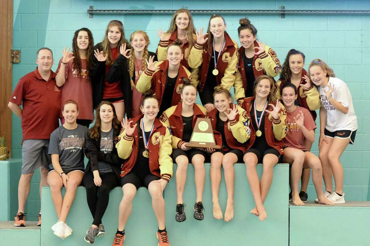 The Cy Ranch girls celebrate their team championship of the UIL Conference 5-6A Regional Swimming and Diving finals on February 4, 2017 at the Don Cook Natatorium, Sugar Land, TX.