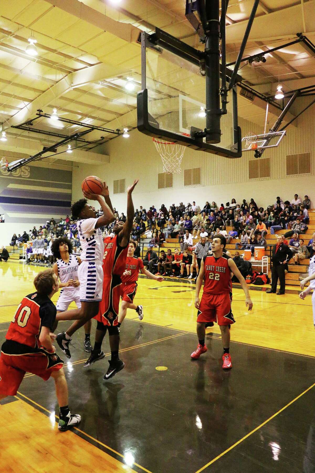 DaytonÂ?'s Julius grabs his own rebound and shoots the ball over several Caney Creek defenders in their contest Friday night.