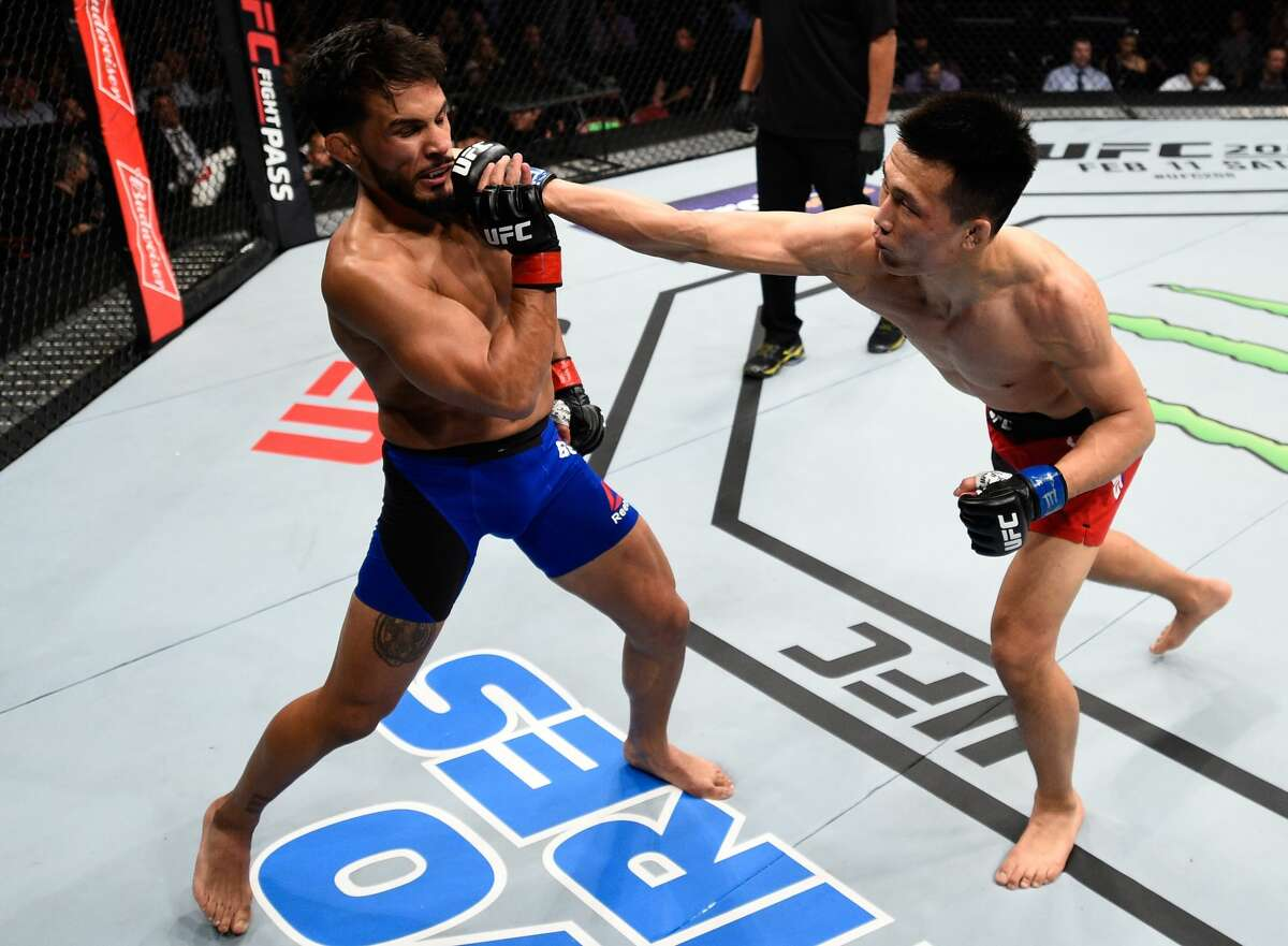 HOUSTON, TX - FEBRUARY 04: (R-L) Chan Sung Jung of South Korea punches Dennis Bermudez in their featherweight bout during the UFC Fight Night event at the Toyota Center on February 4, 2017 in Houston, Texas. (Photo by Jeff Bottari/Zuffa LLC/Zuffa LLC via Getty Images)