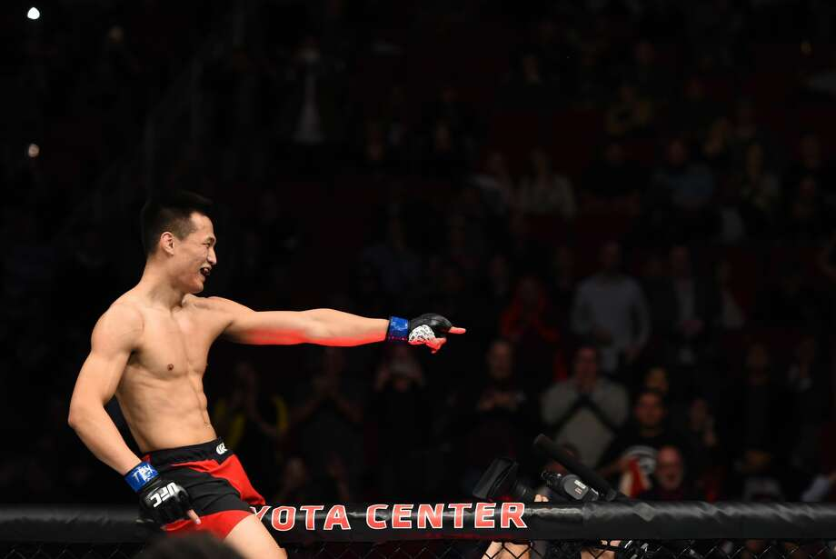 HOUSTON, TX - FEBRUARY 04:  Chan Sung Jung of South Korea celebrates his victory over Dennis Bermudez in their featherweight bout during the UFC Fight Night event at the Toyota Center on February 4, 2017 in Houston, Texas. (Photo by Jeff Bottari/Zuffa LLC/Zuffa LLC via Getty Images) Photo: Jeff Bottari/Zuffa LLC/Zuffa LLC Via Getty Images