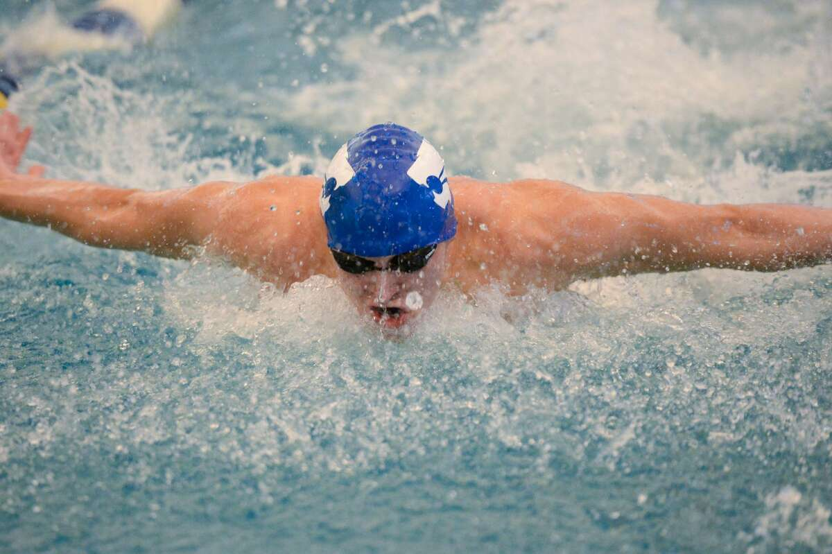 Jared Wallace of Cy Creek swims to a first place finish in the boys 100 yard butterfly at the UIL Conference 5-6A Regional Swimming and Diving Championship on February 4, 2017 at the Don Cook Natatorium, Sugar Land, TX.