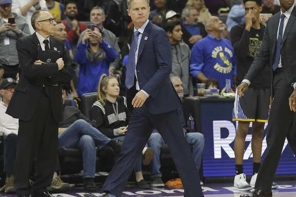 Golden State Warriors head coach Steve Kerr walks off the court after being ejected by referee Bill Spooner during the third quarter of an NBA basketball game against the Sacramento Kings, Saturday, Feb. 4, 2017, in Sacramento, Calif. The Kings won in overtime 109-106. (AP Photo/Rich Pedroncelli)