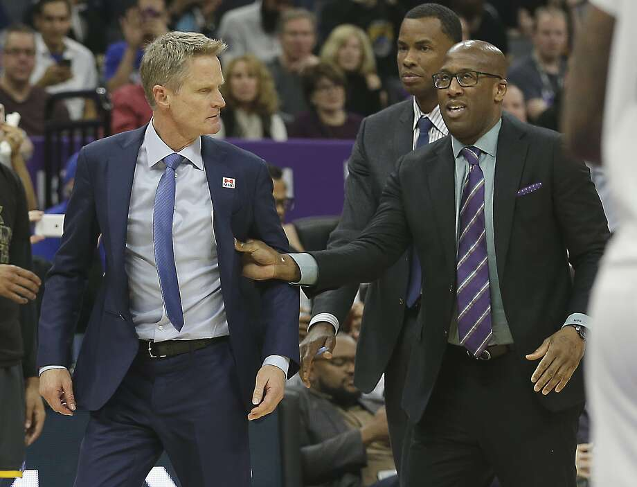 Golden State Warriors assistant coach Mike Brown, right, moves Warriors head coach Steve Kerr, left, off the court after he was ejected by referee Bill Spooner during the second half of an NBA basketball game against the Sacramento Kings, Saturday, Feb. 4, 2017, in Sacramento, Calif. The Kings won in overtime 109-106. (AP Photo/Rich Pedroncelli) Photo: Rich Pedroncelli, Associated Press
