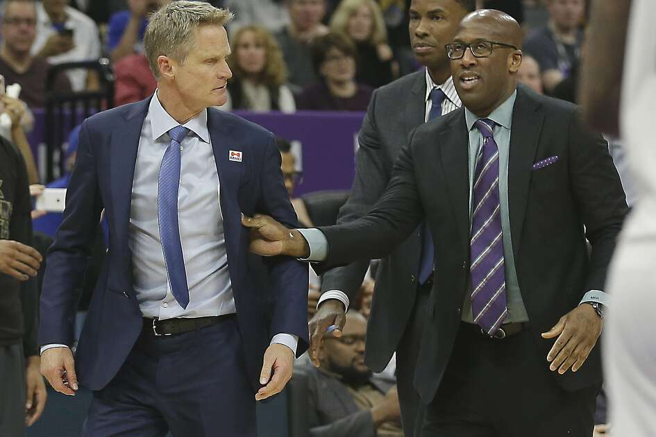 Golden State Warriors assistant coach Mike Brown, right, moves Warriors head coach Steve Kerr, left, off the court after he was ejected by referee Bill Spooner during the second half of an NBA basketball game against the Sacramento Kings, Saturday, Feb. 4, 2017, in Sacramento, Calif. The Kings won in overtime 109-106. (AP Photo/Rich Pedroncelli)