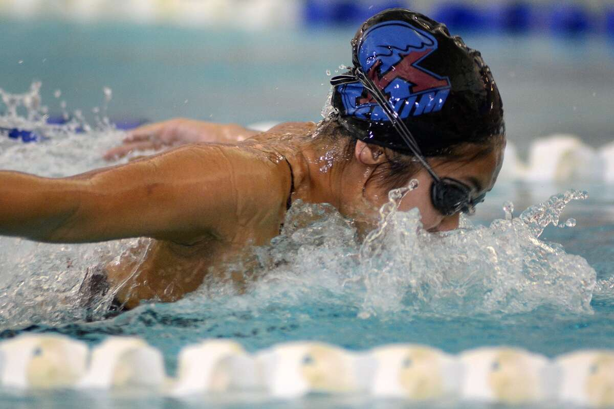 Kempner sophomore Brittany Bui swims her heat of the Girls 100 Yard Butterfly during the 2014 Mustang Holiday Splash at the Friendswood High School Natatorium on Dec. 13th.