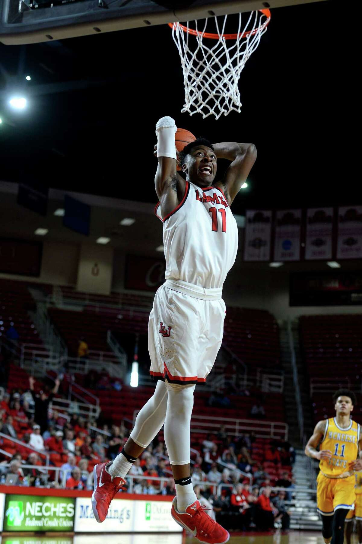 Lamar forward Josh Nzeakor dunks during the first half of a game against McNeese State at the Montagne Center on Saturday afternoon. Photo taken Saturday 2/4/17 Ryan Pelham/The Enterprise
