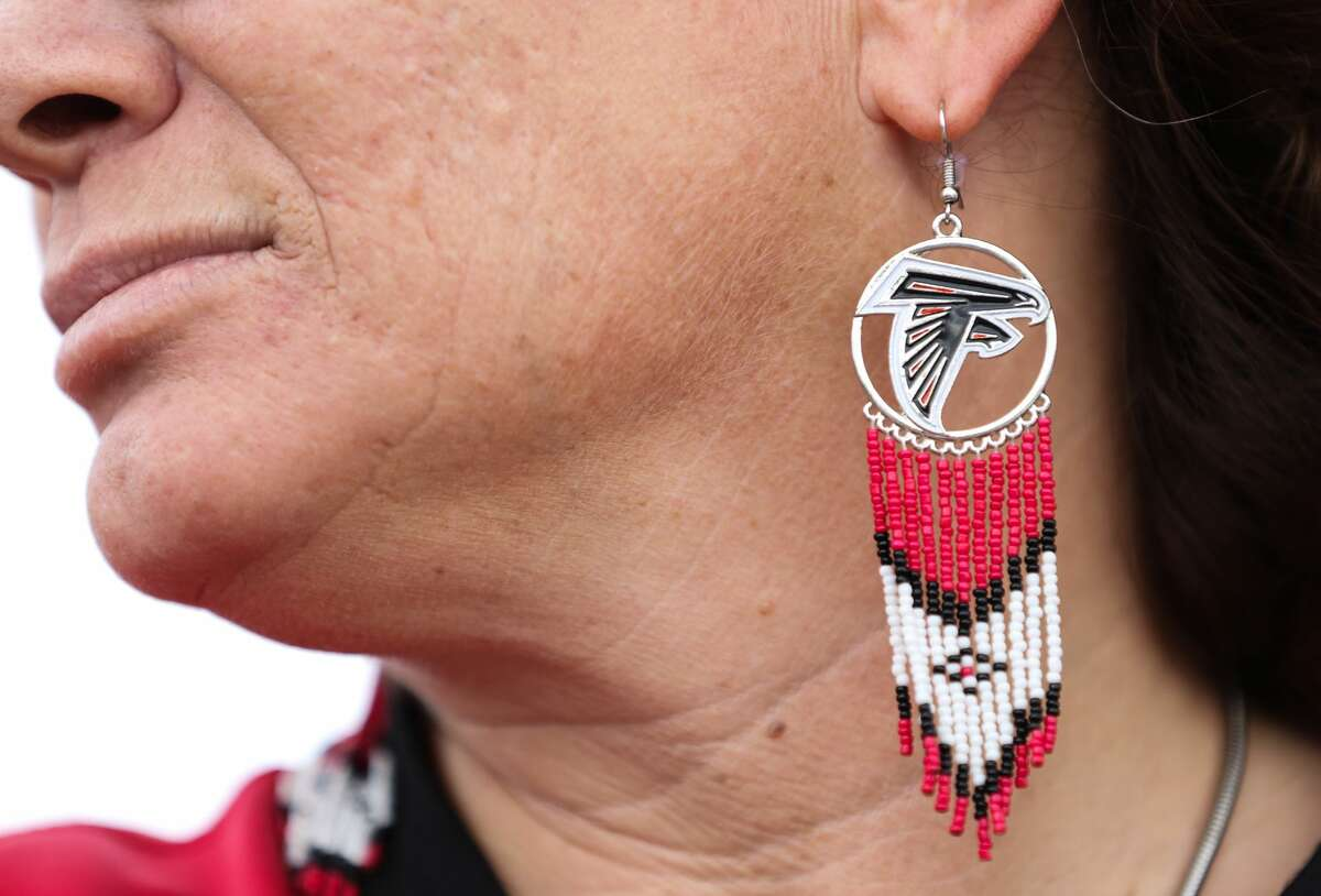 Showing support Atlanta Falcons fan Angela Flanigan wears Falcons ear rings to watch the Super Bowl game on Sunday, February 5, in Houston. Flanigan and her family are Falcons season ticket holders since 1985. ( Yi-Chin Lee/ Houston Chronicle)