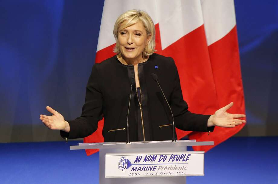 Presidential candidate Marine Le Pen addresses the National Front party conference in Lyon, France. She decried globalization and Islamic fundamentalism. She is a leader in early polls. Photo: Michel Euler, Associated Press