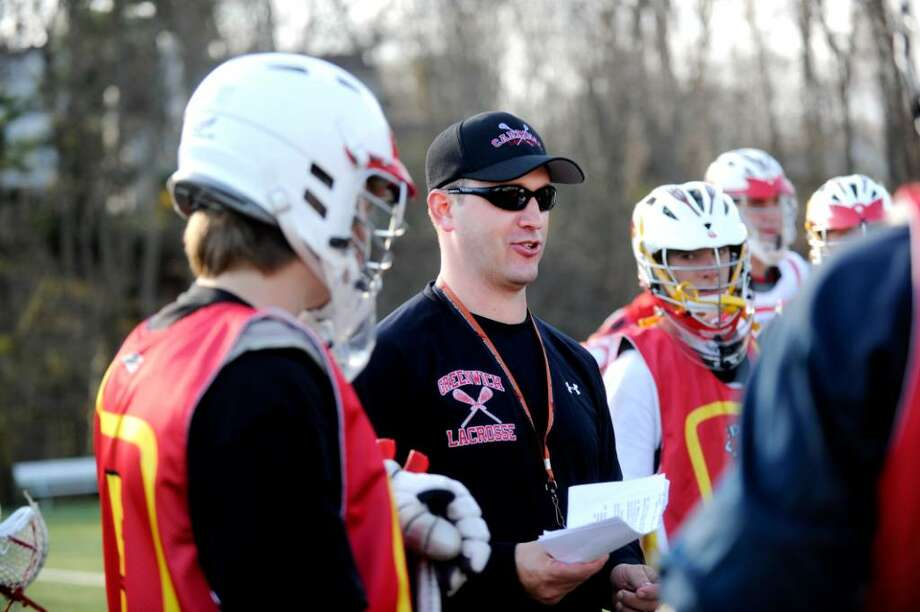 Greenwich High School boys lacrosse coach, Scott Bulkley, speaks to the varsity team during a practice, on Monday, April 5, 2010. 4/6/10 GT photo = Boys Lacrosse Preview. Cardinals ready to soar. Team is committed to rekindling the glory of seasons past. by Jesse Quinlan Photo: Helen Neafsey, Greenwich Time / Greenwich Time