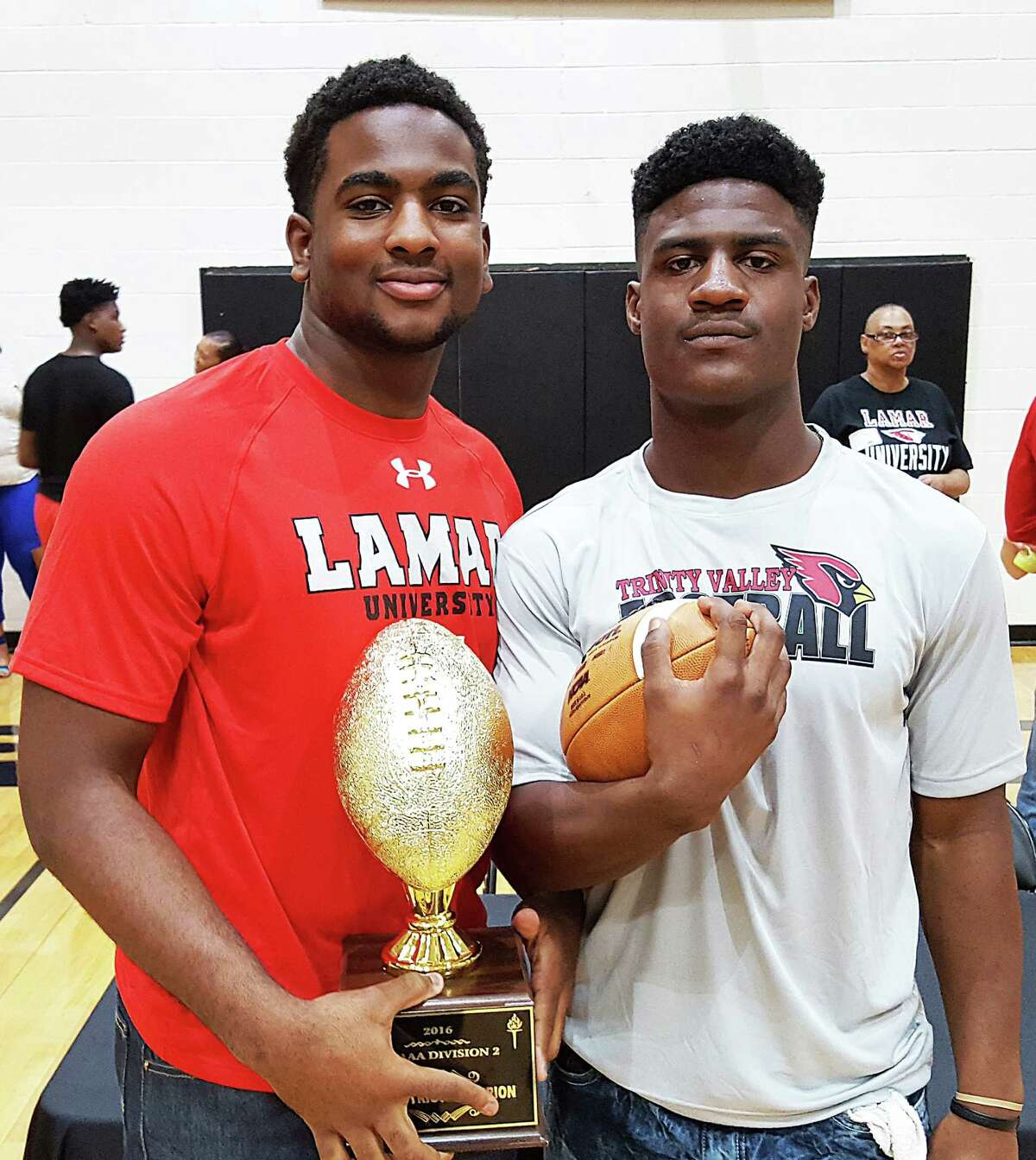 Tyris Williams, left, and Alex Brown from Liberty High School both signed National Letters of Intent to play at the next level. Tyris will be playing for the Lamar University Cardinals and Alex will play at Trinity Valley Community College. Both were instrumental in the success of the Panthers moving to the third round of the football playoffs in 2016.
