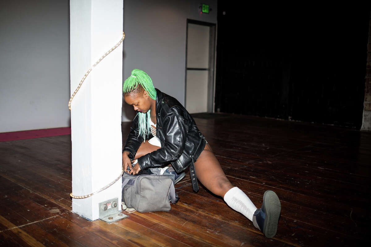 A contestant stretches before performing in the Boss Chick Battle of Seattle Twerk Contest at Studio 206 in Seattle on Saturday, Feb. 4, 2017. Competitors competed for cash prizes, gift cards to Studio 206 and twerking leggings.