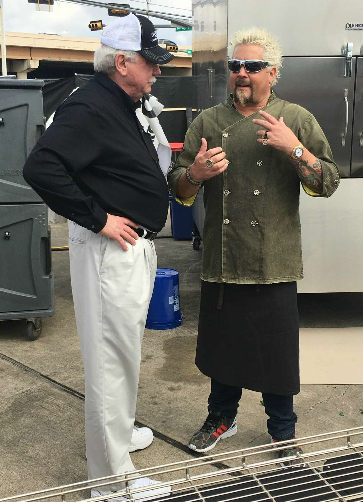 Guy Fieri mans the grills at the Players Tailgate Houston 2017 near the Super Bowl on Sunday afternoon.
