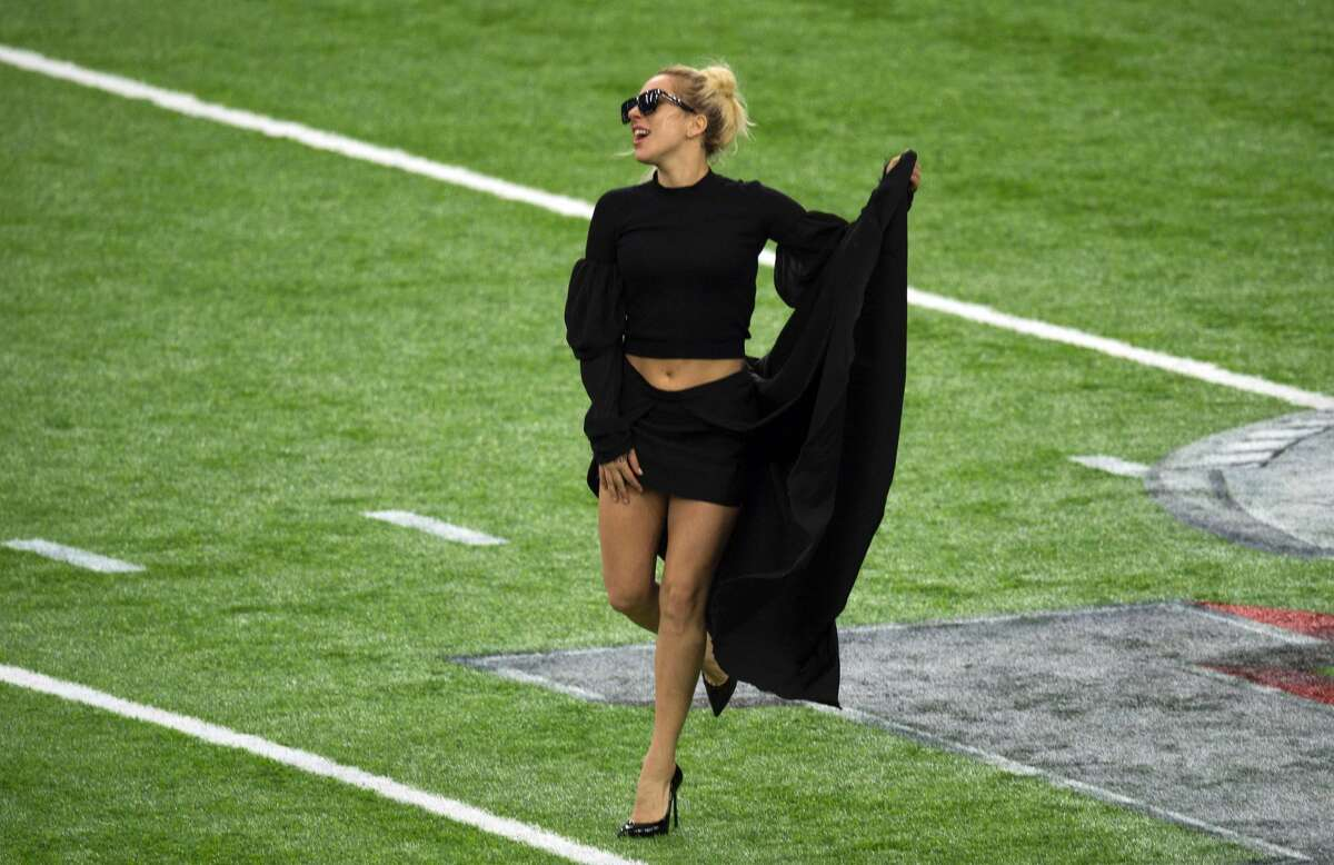 Singer Lady Gaga poses on the field at the Super Bowl LI before the start of the game at Houston NRG Stadium in Houston, Texas, on February 5, 2017. / AFP PHOTO / VALERIE MACONVALERIE MACON/AFP/Getty Images