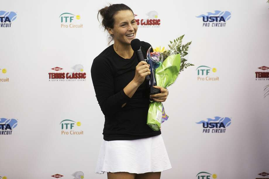 Tatjana Maria speaks to the media and audience after defeating Naomi Broady in the women's championship singles match during the Dow Tennis Classic at the Greater Midland Tennis Center on Sunday. Photo: Theophil Syslo