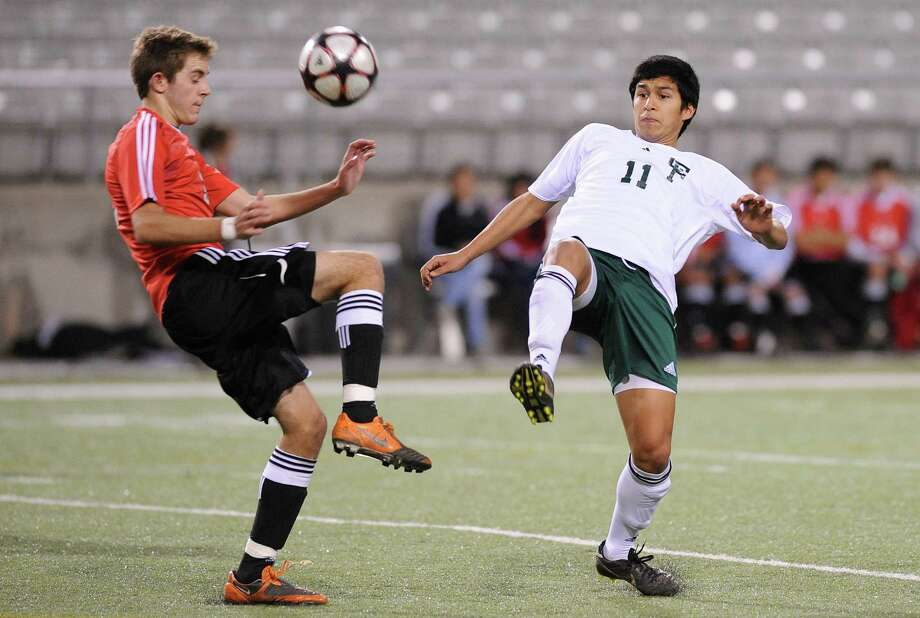 Langham Creek's George Boardley, left, goes against Cy-Falls' Josh Acedo during the soccer game between Cy-Falls and Langham Creek at the Berry Center on 2/19/2010. The Cy Falls and Langham matchup is referred to as 'El Clasico' around the district. Photo by Thomas Nguyen. Photo: Thomas Nguyen, Freelance / Freelance
