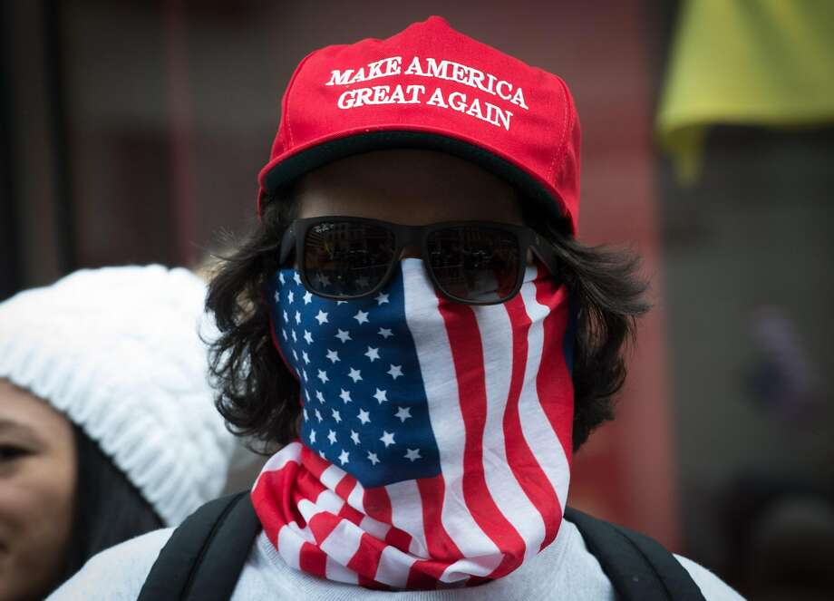 Supporters of US President Donald Trump hold a rally near Trump Tower in Fifth Avenue, February 5, 2017 in New York. / AFP PHOTO / Bryan R. SmithBRYAN R. SMITH/AFP/Getty Images Photo: BRYAN R. SMITH, AFP/Getty Images