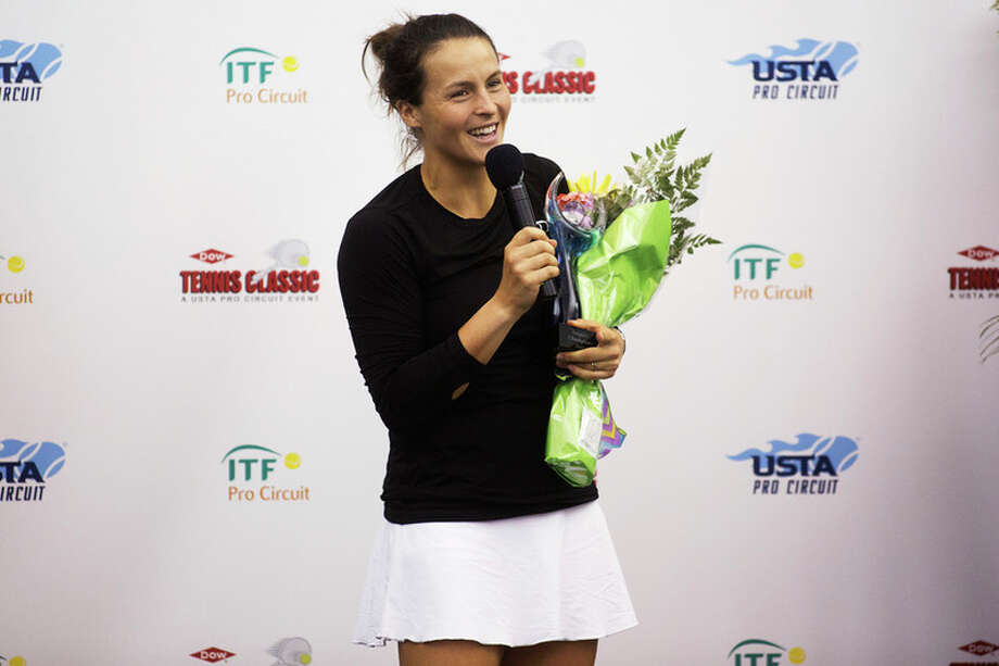 THEOPHIL SYSLO | For the Daily News Tatjana Maria speaks to the media and audience after defeating Naomi Broady in the women's championship singles match during the Dow Tennis Classic at the Greater Midland Tennis Center on Sunday.