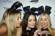 Playmates Monica Simms, from left, Summer Altice, Heather Rae Young and Hiromi Oshima poses look at a selfie on the red carpet at the Playboy party, Saturday, Feb. 4, 2017, in Houston. ( Jon Shapley / Houston Chronicle )