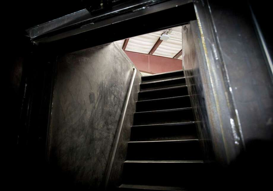 Stairs lead up from a bomb shelter under construction at the Rising S Co. Photo: Joyce Marshall /Fort Worth Star-Telegram / Fort Worth Star-Telegram