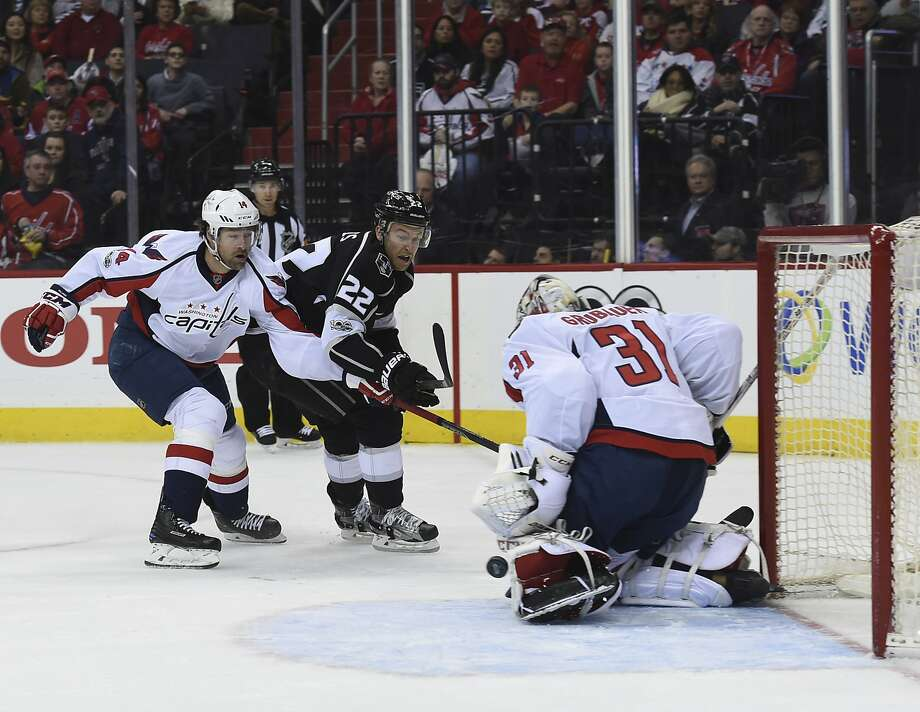 Capitals goalie Philipp Grubauer, who had 38 saves, turns aside Kings center Trevor Lewis' shot. Photo: Molly Riley, Associated Press