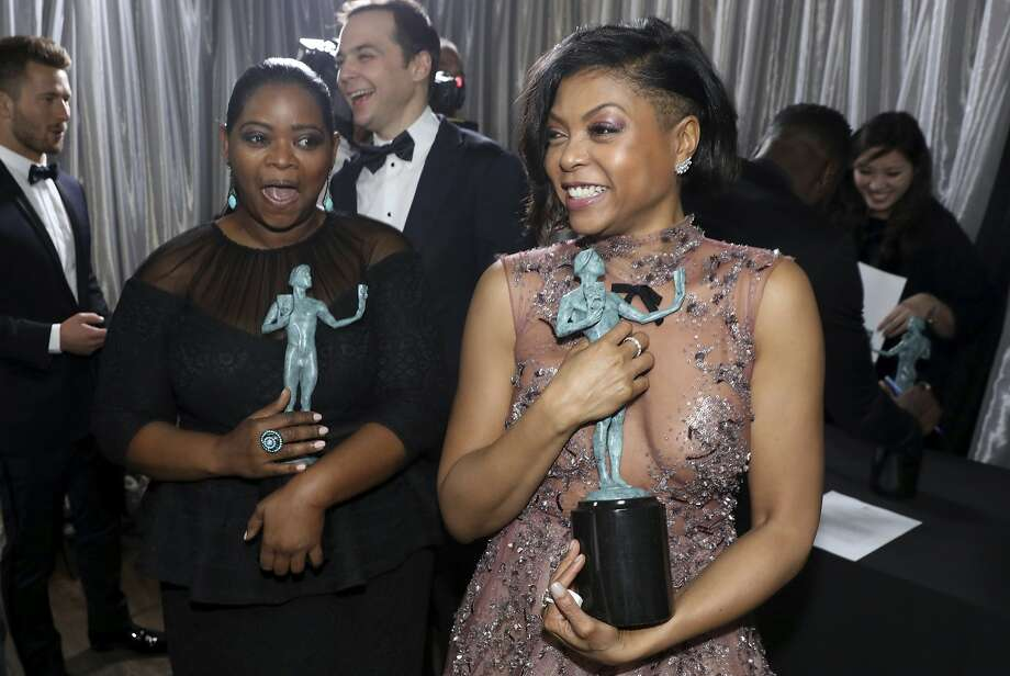 "Octavia Spencer, left, and Taraji P. Henson appear backstage to pick up the award for outstanding performance by a cast in a motion picture for ""Hidden Figures"" at the 23rd annual Screen Actors Guild Awards at the Shrine Auditorium & Expo Hall on Sunday, Jan. 29, 2017, in Los Angeles. (Photo by Matt Sayles/Invision/AP) Photo: Matt Sayles, Associated Press"