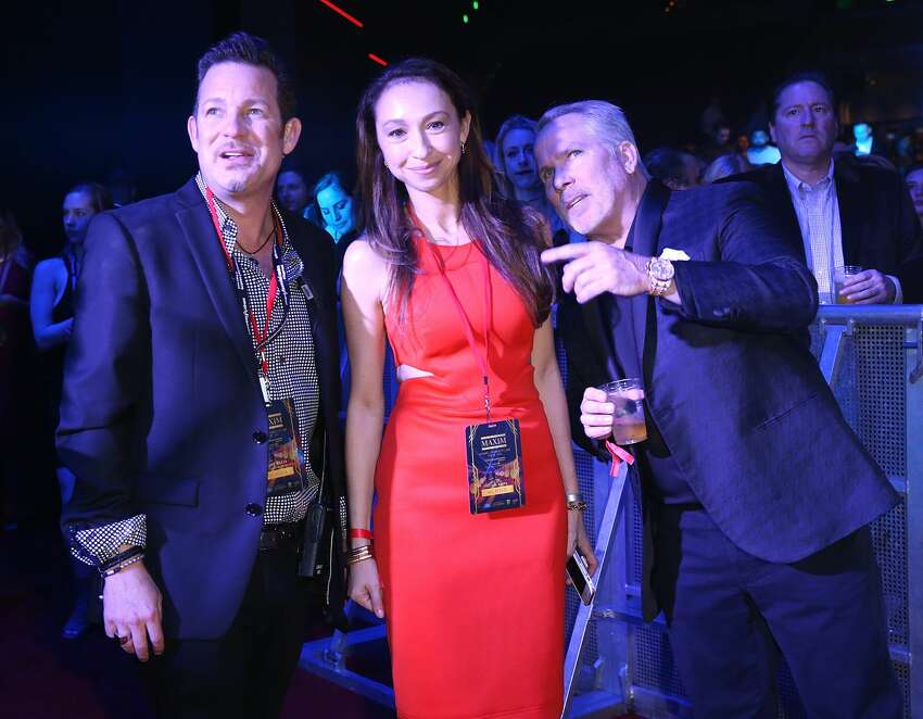 HOUSTON, TX - FEBRUARY 04: (L-R) CEO of Karma International Dylan Marer, attorney Thomas J. Henry, and wife Azteca Henry attend The MAXIM Super Bowl 2017, presented by Thomas J. Henry and produced by Karma International, at the Smart Financial Centre at Sugar Land on February 4, 2017 in Houston, Texas. (Photo by Joe Scarnici/Getty Images)