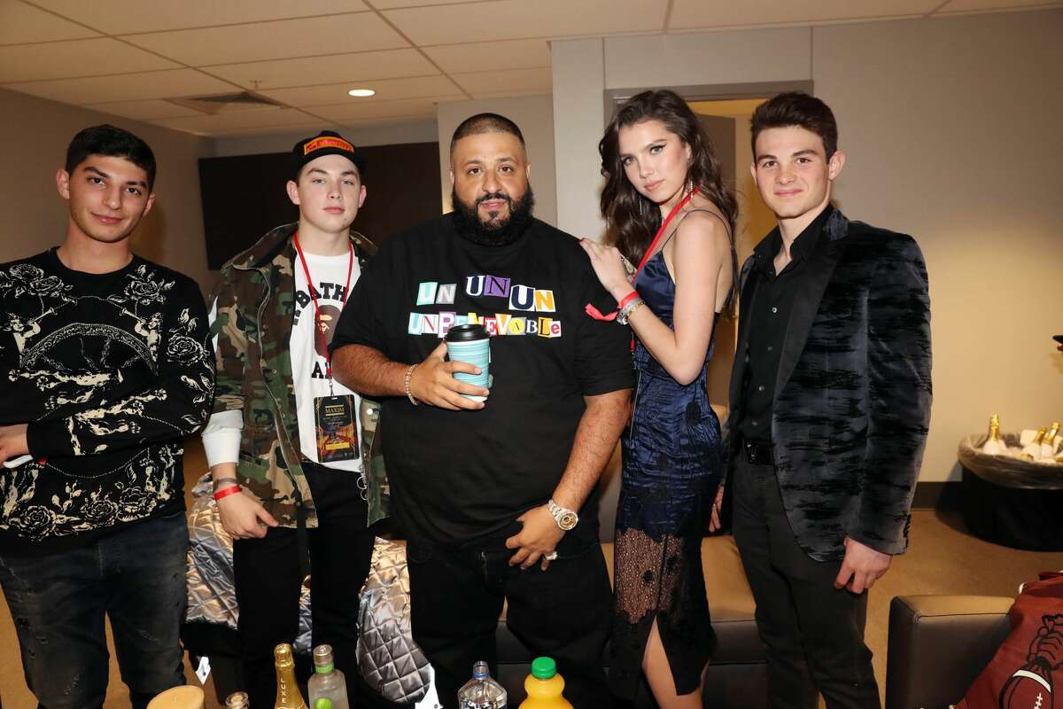 SUGAR LAND, TX - FEBRUARY 04: DJ Khaled (c) and Maya Henry (2nd r) pose with guests backstage at the 2017 Maxim Super Bowl Party at Smart Financial Centre on February 4, 2017 in Sugar Land, Texas. (Photo by Johnny Nunez/FilmMagic)